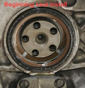 Flywheel removal warning, main seal, oil pump cover, oil pump
